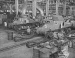 Workers putting tracks onto a M3 tank at the Detroit Arsenal Tank Plant, Warren, Michigan, United States, circa 1940-1942, photo 2 of 2