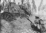 Australian troops and M3 General Stuart light tank fighting near Buna, New Guinea, Jan 1943