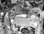 Servicing the engine of a M8 armored car, date unknown
