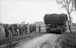 Churchill AVRE fascine carrier passing British infantrymen during the attack towards Hertogenbosch, the Netherlands, 23 Oct 1944