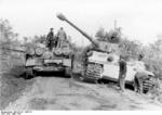 Camouflaged German Army Sturmpanzer assault gun and Tiger I heavy tank at Nettuno, Italy, Mar 1944