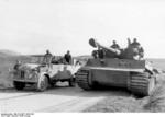 German Tiger I heavy tank and another vehicle on a road in Tunisia, 26 Feb 1943