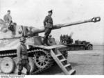 German Waffen-SS General Walter Krüger with a Tiger I heavy tank and an anti-aircraft gun vehicle of his 2nd SS Panzer Division