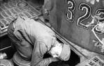 German tanker performing maintenance on a Tiger I heavy tank, near Kursk, Russia, summer 1943, photo 1 of 2