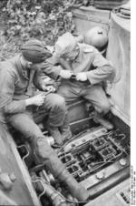 German tanker performing maintenance on a Tiger I heavy tank, near Kursk, Russia, summer 1943, photo 2 of 2