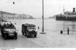 German SdKfz. 250 halftrack vehicle in a port in Southern France, 1942; note passenger ship Maréchal Lyautey in background
