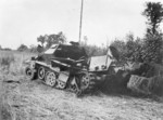A wrecked German SdKfz. 251 halftrack vehicle in Northern France, victim of USAAF 9th Air Force fighters, 26 Jul 1944