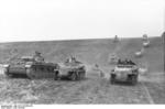 Panzer III tanks and SdKfz. 251 halftrack vehicles of the German 23rd Panzer Division on the move in Southern Russia, 21 Jun 1942