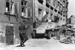 Polish insurgent fighters with captured German SdKfz. 251 halftrack vehicle, Warsaw, Poland, 14 Aug 1944, photo 2 of 6; Kopernik Street