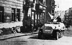 Polish insurgent fighters with captured German SdKfz. 251 halftrack vehicle, Warsaw, Poland, 14 Aug 1944, photo 3 of 6; Tamka Street