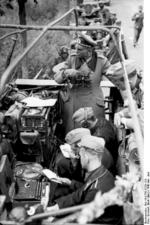German General Heinz Guderian in a SdKfz. 251/3 halftrack vehicle, France, May 1940, photo 3 of 6; note early 3-rotor Enigma machine