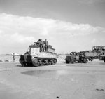 Sherman BARV vehicle towing a disabled Bedford truck, Normandy, France, 14 Jun 1944