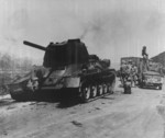 Destroyed T-34 tank on a road toward Gimpo Airfield, Korea, 17 Sep 1950