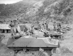 Soldiers of Australian 37/52 Infantry Battalion posing with captured Japanese Type 2 Ka-Mi amphibious tanks, near Lakunai airstrip and Rabaul, New Britain, Solomon Islands, 14 Sep 1945