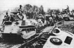 Japanese Type 89 I-Go medium tanks and troops moving toward Manila, Philippine Islands, 22 Dec 1941