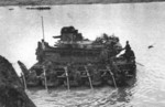 Type 89 I-Go medium tank being ferried acrossed a river, date unknown