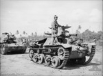 Japanese tank crew bringing a Type 95 Ha-Go light tank to men of Australian 2/4 Armoured Regiment after surrendering Rapopo Airfield, New Britain, Solomon Islands, 28 Sep 1945