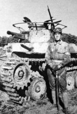 Japanese tanker with a Type 97 Chi-Ha medium tank, date unknown