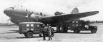 Dodge WC54 and WC64 KD 3/4-ton field ambulances standing by C-46 Commando aircraft at Clark Field, Manila, Philippine Islands, 29 Sep 1945