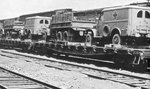 Dodge WC27 1/2 ton ambulances and CCKW 21/2 ton trucks loaded on railway flat cars for shipment from manufacturing plants to points of embarkation, circa 1941