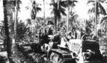 155mm Gun M1 of the US Marine Corps being towed on the island of Rendova, Solomon Islands, Jul 1943