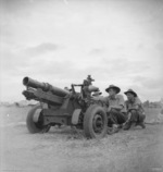 Australian crew of a Baby 25 pr field gun in Markham Valley, New Guinea, 28 Aug 1944; they were Sergeant J. O. Kennedy, gunner J. L. Kirby, and gunner T. M. Naughtin