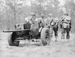 37 mm Gun M3 piece being manhandled into position, Fort Benning, Georgia, United States, Apr 1942