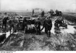 German motorized troops traveling on muddy road in Poland, Sep 1939