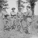 Troops of British 59th Division with a captured German 8 cm GrW 34 mortar, Vienne-en-Bessin, France, 1 Aug 1944