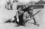 Instructional or propaganda photograph of a Japanese Army soldier carrying a wounded comrade, date unknown