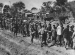 Japanese soldiers escorting a column of Chinese prisoners of war, China, circa late 1937 to early 1938