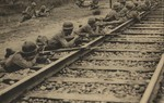 Japanese troops guarding a section of a railway near the village of Zhangxindian near Beijing, China; seen in the 1 Sep 1937 issue of the Japanese publication Asahigraph