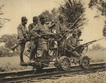 Japanese Army soldiers with Arisaka Type 38 rifles on a hand cart, China, 1937; seen in the 1 Sep 1937 issue of the Japanese publication Asahigraph