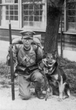 Japanese Army Private 1st Class with dog and Arisaka Type 38 rifle, date unknown