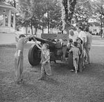 Civilians looking at a French-built 75mm field gun, Bristol, Vermont, United States, Jul 1940