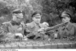 A German general inspecting troops at San Felice Circeo, Italy, 26 Dec 1943; note FG 42 rifle