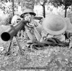 Recruits of the Singapore Volunteer Force training with a Lewis machine gun, Nov 1941