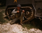 US Army soldier posing with his M1 Garand rifle next to a M3 halftrack, Fort Knox, Kentucky, United States, Jun 1942, photo 1 of 4