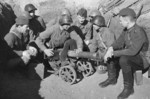 Soviet brigade commissar Veselov with a machine gun crew, Russia, Apr-May 1942; note Maxim M1910 machine gun