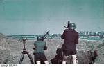 A German soldier aiming with a MG 13 machine gun while filmmaker Horst Grund operated his camera, Constanta, Romania, circa 1941, photo 2 of 2