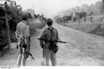 German soldiers guarding an Italian road, 1944; note German MP 40 and Soviet PPSh-41 submachine guns