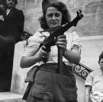 Simone Segouin (nom de guerre Nicole Minet) posing with a MP 40 submachine gun, 23 Aug 1944