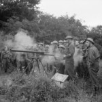 British War Office personnel instructing Home Guard personnel on the use of a Northover Projector in Saxmundham, Suffolk, England, United Kingdom, 30 Jul 1941