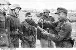 German non-commissioned officer demonstrating the Panzerfaust weapon, Russia, Sep 1943, photo 1 of 2