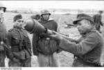 German non-commissioned officer demonstrating the Panzerfaust weapon, Russia, Sep 1943, photo 2 of 2