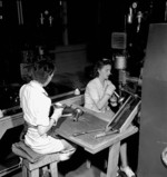 Two female workers assembling PIAT anti-tank launher parts, Orilla, Ontario, Canada, Jun 1944