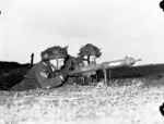 Private L. H. Johnson and Sergeant D. R. Fairborn of 1st Canadian Parachute Battalion with a PIAT launcher, Lembeck, Germany, 29 Mar 1945
