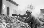 British soldier with PIAT at Saint-Martin-des-Besaces, Basse-Normandie, France, 1 Aug 1944