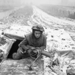 PIAT gunner of 1st Battalion Rifle Brigade, British 7th Armoured Division, 28 Dec 1944