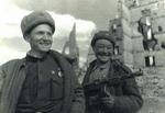 Two Soviet soldiers in Stalingrad, Russia, circa 1942-1943; note the Central Asian soldier and his PPD-40 submachine gun